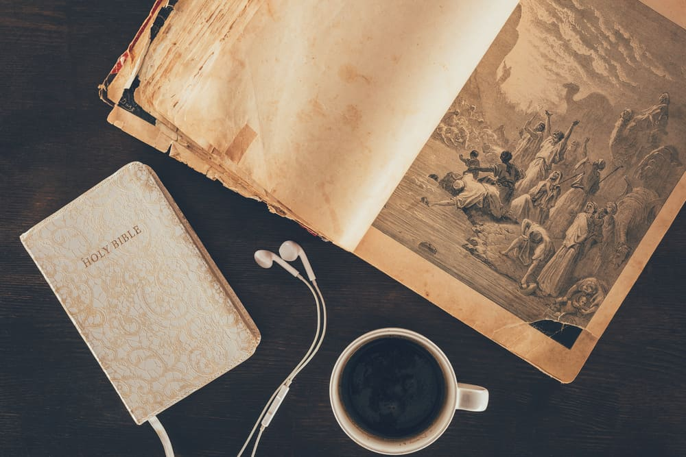 Relationship, not religion Bible with coffee and earphones